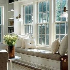 beautiful windowseat with the backdrop of colonial bar windows for a hamptons style #design #exclusivestylehamptons #hamptonsstyle