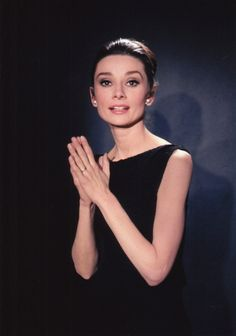 "The actress Audrey Hepburn photographed by Vincent Rossell at the Studios de Boulogne, located on Avenue Jean-Baptiste-Clément, in Boulogne-Billancourt, a French commune in the Hauts-de-Seine départment, region of Île-de-France, in the western suburbs of Paris, during a photo shoot for the publicity material of her new movie ""Charade"", in January 1963. Audrey was wearing:Cocktail dress: Givenchy (of black cloqué silk, sleeveless and with a high boat neckline in front that plunges to a deep…"