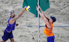 DAY 1:  Men's Beach Volleyball - Russia vs the Netherlands - Dmitri Barsouk of Russia and Robert Meeuwsen of the Netherlands