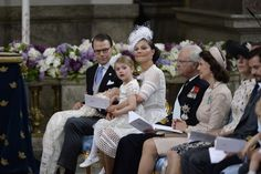 Princess Estelle on mamma Victoria's lap probably peek at cousin Prince Nicolas who was making funny sound....
