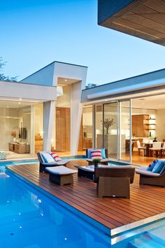 Awesome Backyard Deck Surrounded By The Swimming Pool