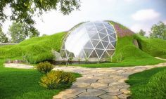 Grass-covered geodesic dome home from Romania.