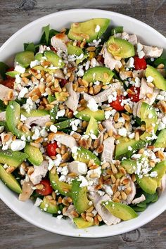 This power salad is super simple: chicken, avocado, pine nuts, feta cheese, tomatoes and spinach. I love it topped with Garlic Expressions salad dressing. The flavor is utter perfection! This salad is hearty enough for dinner and excellent for entertaining!