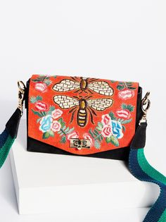 Stella Crossbody | Cute crossbody featuring a textured animal print and suede flap. Switch it up and sport it as a clutch using a removable leather strap with simple stud details throughout. Chic twist lock closure.
