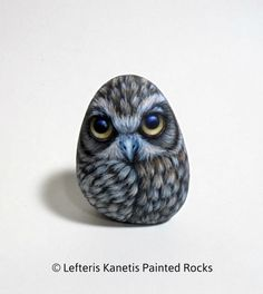 Fluffy Owl With Big Eyes Hand Painted Stone ! A great handmade 3D painted stone made by me ! This stone is sharpened with a special wheel to stand upright and is painted from all sides with a lot of detail.  Is painted on a smooth sea stone which i have collected from a beach on a Greek island. Is painted with fine art quality acrylic colors and very small brushes for the detail , is signed on the back and covert with strong glossy acrylic stone varnish for protection.  Dimensions…