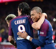 Kylian Mbappe celebrates with Edinson Cavani after PSG score against Lyon as Paris eventually win 2-0 on Sunday evening