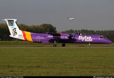 Flybe (UK) De Havilland Canada DHC-8-402Q Dash 8 G-FLBD aircraft, named ''Spirit of Inverness'' Oct. 2014, with the inscription ''faster than road or rail'' on the airframe, skating at the Netherlands Amsterdam Schiphol International Airport. 01/11/2014.