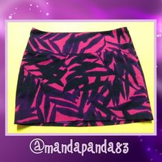 Zebra Print Mini Skirt EUC Great Gift IN LIKE NEW CONDITION! This skirt is HOT!!! It is a mixture of hot pinks & purples on a black skirt. Side zipper, hook closure & fully lined. No condition issues! Express Design Studio Skirts Mini