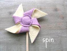 Felt pinwheel hair clip by OrdinaryMommy via Etsy.