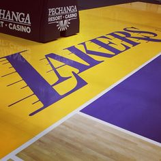 We've changed up the look along the baseline on the #NewLakersCourt. Gone is the block type in the purple box, in its place is the script font from our primary logo.
