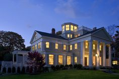 House at dusk, with lantern and roof deck - Traditional - Exterior - Boston - Helios Design Group