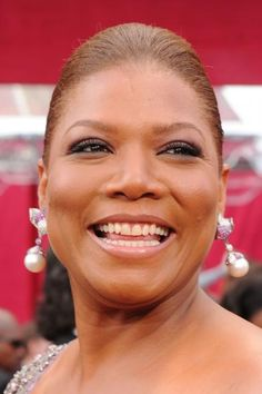 Queen Latifah -   Dana Elaine Owens (born March 18, 1970), better known by her stage name Queen Latifah, is an American singer, rapper, and actress. Her work in music, film and television has earned her a Golden Globe award, two Screen Actors Guild Awards, two Image Awards, a Grammy Award