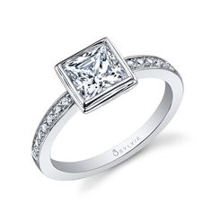 Active women who adore the outdoors need a practical engagement ring. The princess diamond is set in a low-profile, bezel-setting protecting the center stone when working out, gardening, riding bikes or just plain living!
