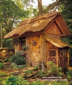 Cordwood chicken rabbit coop with thatched roof