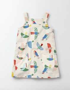 This dungaree-style dress is perfect for a busy day building dens or climbing trees. The simple shape is comfortable and easy to wear, while handy patch pockets on the front are great for storing the map to your secret hideout.