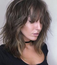 Shag with Disconnected Razored Layers Razored layers with beachy waves in a medium length shag are the perfect accessory for every season. This length of bangs gives a peek-a-boo vibe, and they're still long enough if you want them out of your face. Medium Length Hair With Layers, Medium Hair Cuts, Medium Hair Styles, Curly Hair Styles, Shaggy Medium Hair, Medium Choppy Layers, Hairstyles For Medium Length Hair With Bangs, Long Shaggy Bob, Shag Bob
