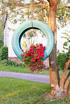 with spray paint, chain, and a hook - transform an old tire into a planter.