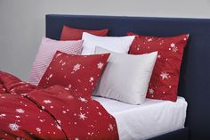 Bright white snowflakes stand out against a red background in the SNÖ design. White Snowflake, Snowflakes, Linen Bedding, Bed Linen, Red Background, Comforters, Throw Pillows, Blanket, Bright