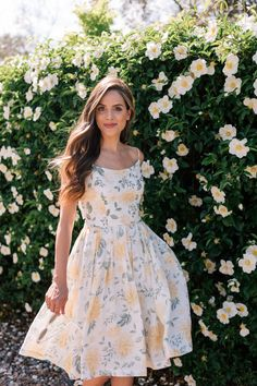 Obsessing over how gorgeous this yellow floral Gal Meets Glam Abigail dress is! yellow floral sundress flowers summer style spring feminine romantic women's clothing what to wear to easter summer wedding garden long brown hair with soft waves