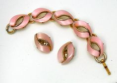 Unmarked goldtone bracelet & earrings. Sturdy cast metal settings, well made. Either shell or pearlescent glass - I presume glass.