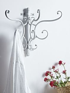 Set upon a simple antiqued white wall fixing these three double hooks feature b
