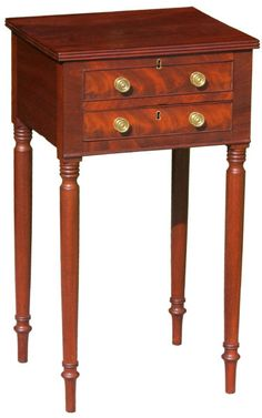 """a diminutive Baltimore, Maryland Federal Sheraton style mahogany lift-top work table, c.1815; the triple reeded top edge, multiple ring turnings on the legs, and characteristic """"Regency"""" trumpet feet are all Baltimore cabinetmaking traits, seen as well on a Maryland dining table found in Weidman's book Furniture in Maryland, 1740-1940 (fig.151); the combined use of """"baywood"""" mahogany for the drawer sides and tulip poplar for the bottoms is also an attribute of Baltimore furniture of the…"""