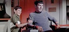 It's hard not to laugh when you see Leonard Nimoy as Spock smiling at a practical joke on the set of Star Trek TOS. The crew had secretly made his son Adam up as a Vulcan child to surprise him. Star Trek Cast, Star Trek Spock, Star Wars, Star Trek Bloopers, Dr Spock, Leonard Nimoy, Star Trek Original Series, Star Trek Series, Tv Series