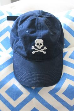 Needlepoint baseball cap.