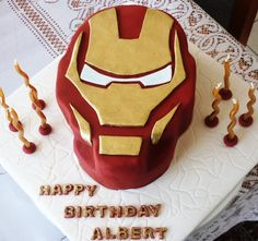 """Iron Man Birthday cake carved out of an 8"""" round cake"""