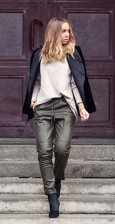 Lisa Olsson is wearing a black blazer from By Malina, light khaki jumper from Davida Cashmere, olive trousers from H&M and ankle boots from Jennie-Ellen