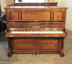 A 1909, Bechstein model 9 upright piano with a rosewood case at Besbrode Pianos. Piano has an eighty-five note keyboard and two pedals.