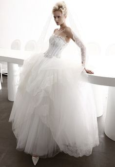 Strapless long white wedding dress with full skirt & tiered tulle flounces from Atelier Aimee.