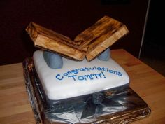 """Karate Cake - I made this for my cousin who received his black belt in Karate this weekend. The """"boards"""" are styrofoam covered in fondant that I painted with food coloring to look like wood. The """"rocks"""" holding up the """"wood"""" is rice crispy treats covered in fondant."""