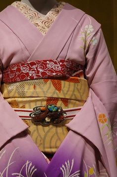 The obidome of a maiko is huge, showy, and often encrusted with precious or semiprecious stones.