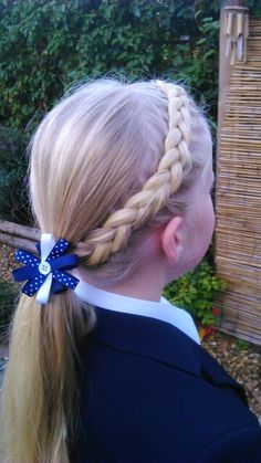 Dutch braid across the front and into a ponytail