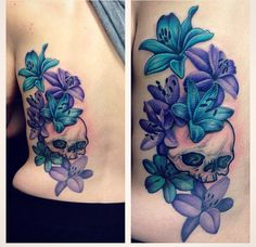 Skull and lily back tattoo. Colourful purple and blue lily with black and grey shade back tattoo.