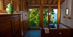 Magnificent Balinese-style cliff-top luxury home for sale in Tobago perched on a cliff offering stunning sea views.