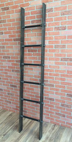 Wooden Iron Pipe Decor Ladder by WilliamRobertVintage on Etsy https://www.etsy.com/listing/263217070/wooden-iron-pipe-decor-ladder