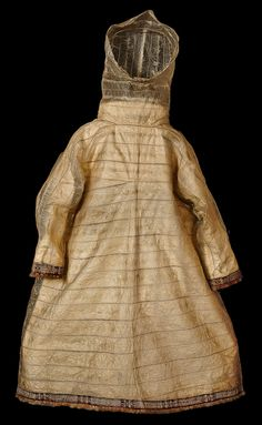 Seal intestine waterproof hooded coat. 20,000 plus embroidery stitches in the border alone. The cuffs and hem of 14 thin bands of parchment-like sealskin are dyed red and black, overwoven with caribou-hair in geometric patterns. Aleutian Islands.