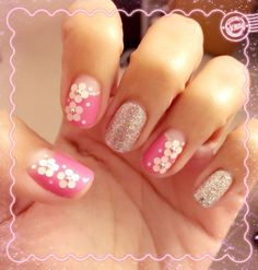 Pink with little white flowers nail art