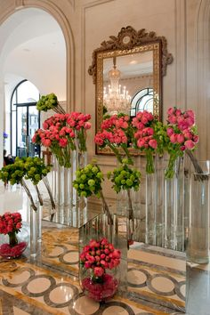 Does anywhere do romance quite like Paris? Modern floral displays are bold and bright against @Mandy Bryant Bryant Dewey Seasons Hotel George V Paris' opulant decor.