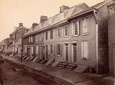 """""""Shown here are old Swedish houses on Queen [i.e. Christian] Street, near the river front, between Front and Water Streets.""""--OPEP, p. 3. 1865"""