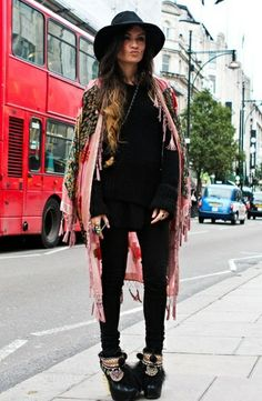 Fringed boho kimono paired with basic black. This is classic Madame de Rosa style. Boots and all.