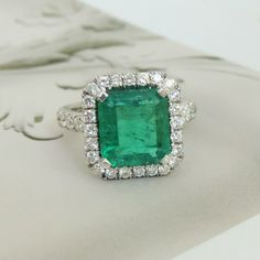 OH MY goodness I am green with envy for this gorgeous Approx. 3.25 Carat Emerald 1.62 cttw Diamond Halo 18K White Gold Ring