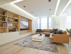 idée d'éclairage LED dans le salon en spots et corniche lumineuse