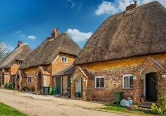 Part of a charming row of ten thatched estate cottages at Leverton in Wiltshire, England.