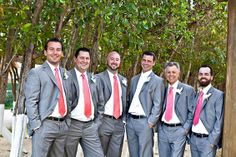 These coral and pink ties are the perfect pop of color for a tropical wedding