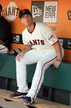 Buster Posey watches his teammates from the dugout, June 23, 2011.