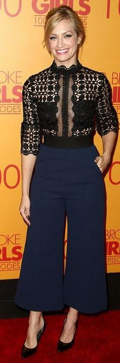 Who made Beth Behrs' blue pants and black lace top?