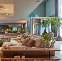 Almofadas e mantas em ovelha Elisa Atheniense Home no ambiente criado pela arquiteta Carolina Jardim